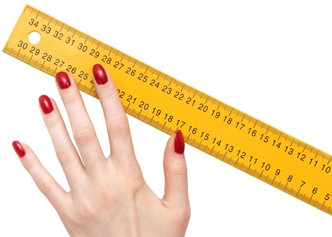 woman hand with ruler