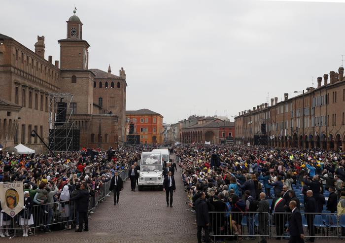 Pope Francis arrives in Piazza Martiri Square to celebrate Mass, in Carpi, northern Italy, for a one-day pastoral visit to Carpi and Mirandola, Sunday, April 2, 2017. Francis has arrived in the northern Emilia Romagna region hit by deadly quakes in 2012 on a visit meant to signal hope to central Italy, struck by a series of more devastating temblors last year. (ANSA/AP Photo/Antonio Calanni) [CopyrightNotice: Copyright 2017 The Associated Press. All rights reserved.]