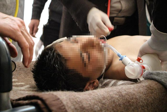 At least 58 killed in suspected gas attack in northern Syria