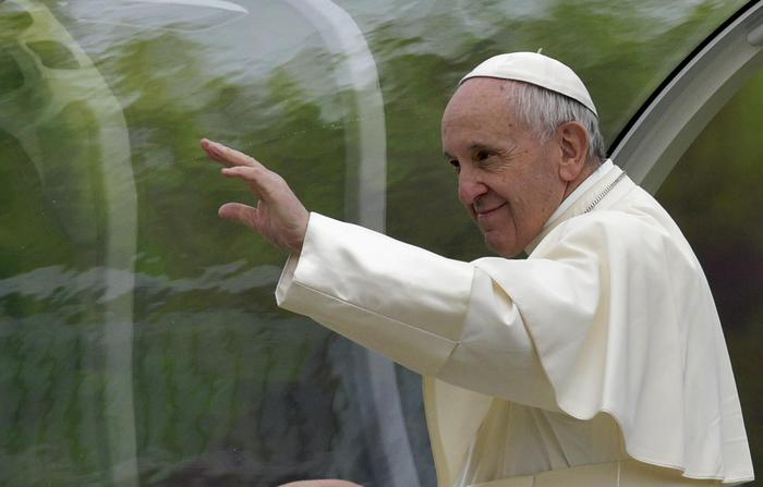 Pope Francis arrives at Dorando Pietri stadium in Carpi, northern Italy, for a one-day pastoral visit to Carpi and Mirandola, Sunday, April 2, 2017. Francis has arrived in the northern Emilia Romagna region hit by deadly quakes in 2012 on a visit meant to signal hope to central Italy, struck by a series of more devastating temblors last year. (ANSA/AP Photo/Marco Vasini) [CopyrightNotice: Copyright 2017 The Associated Press. All rights reserved.]
