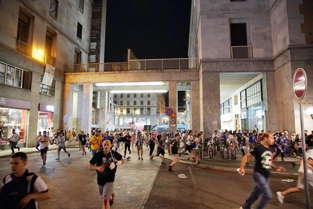 People flee San Carlos Square during a televised viewing of the Champions League Final after false reports of a bomb